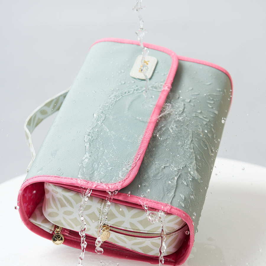Waterproof finish on green hanging wash bag