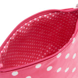 inside of small red polka dot make-up bag with dotty lining