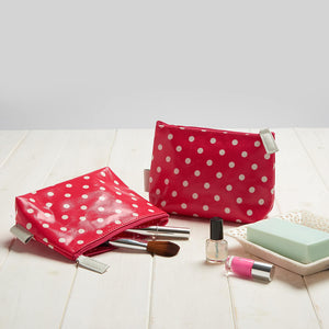 detail of make-up bag in red polka dot print