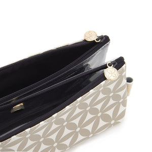 Folding makeup bag with compartments and magnetic fastening in gold