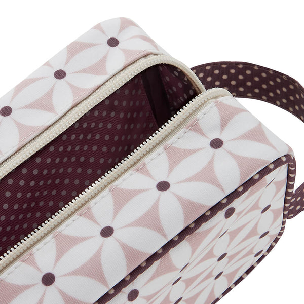 Travel makeup bag close up of cosmetic bag with handle in blush starflower print