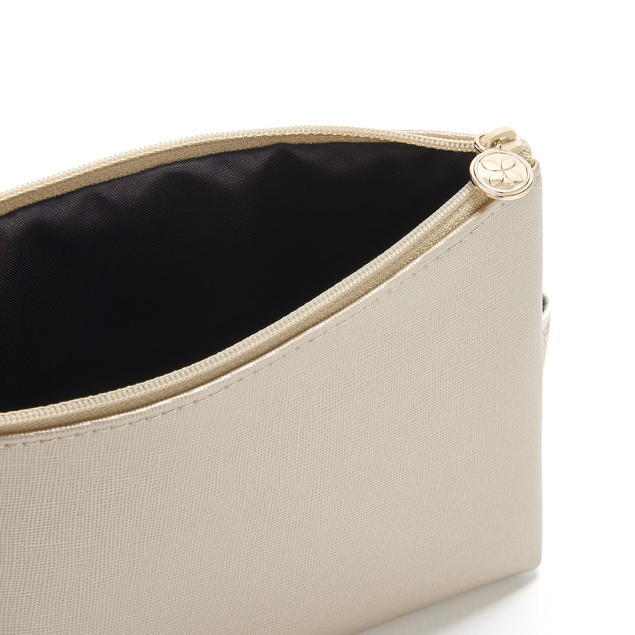 small makeup bag in gold with waterproof lining