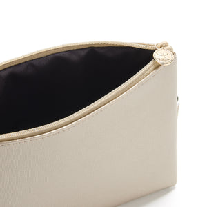 small makeup bag in gold