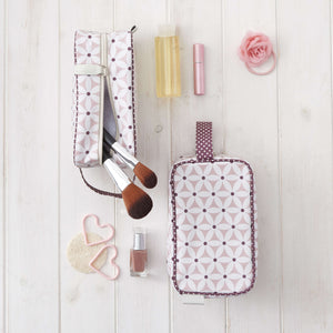 Travel make up bag in pale pink starflower print