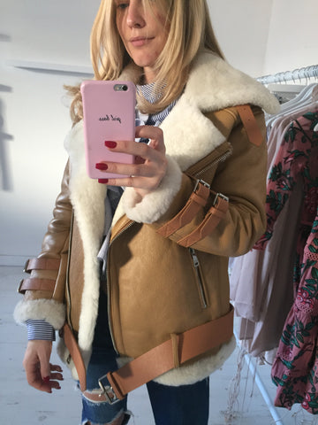 911f98736b77 ... yet chic Shearling Coat - because we all know how cold London can be in  the winter. This combination is sure to make front-page news in our opinion.