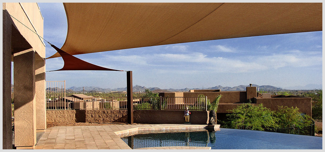 Pool-side shade sails in the desert