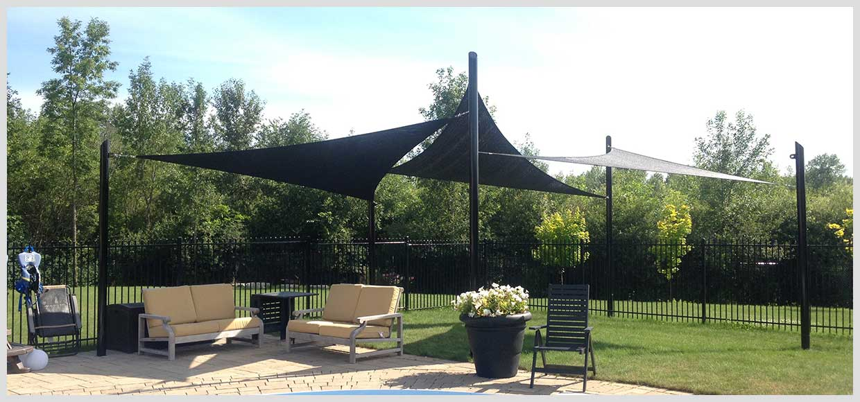 Grassy poolside shade sail canopies