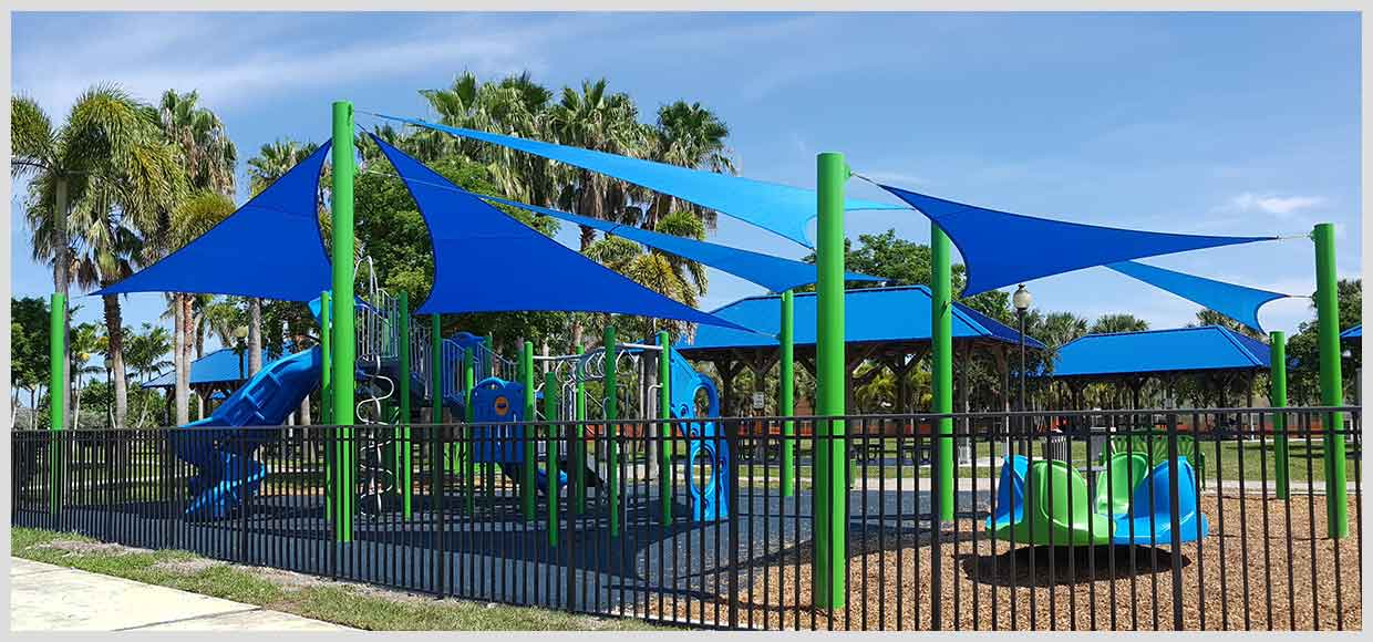 Blue sails on a blue and green playground