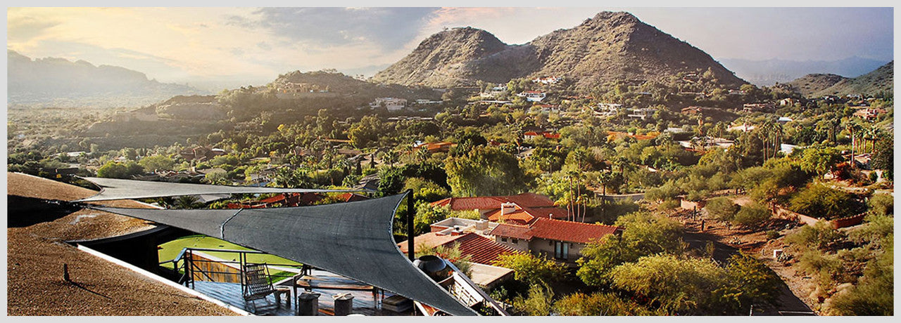 Two black triangular shade sails overlooking Paradise Valley
