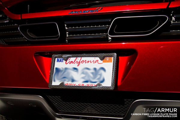 Carbon fiber TagArmur license plate frame on a McLaren