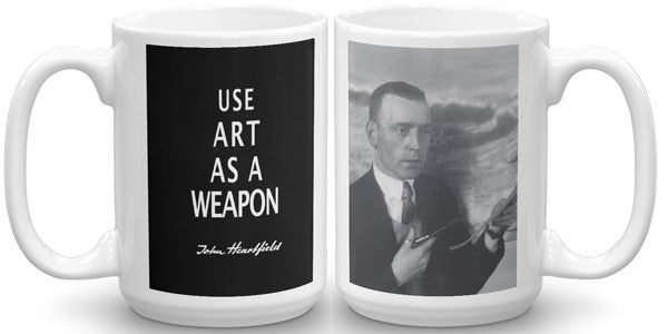 "Famous political sloganan ""Art As A Weapon"" mug in The Official John Heartfield Exhibition Shop."