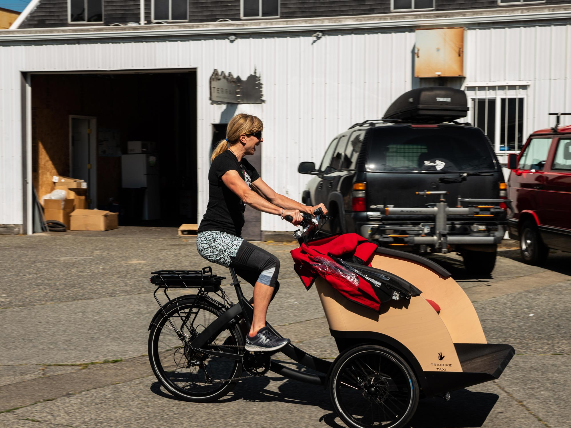 Tammy testing out the newly un-boxed Triobike!