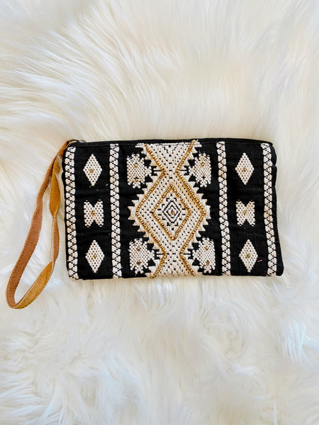 Pouch Wristlets at Multitudes Boutique - The Avila Seed Bead Clutch isn't your average Leather Strap Wristlet! This Clutch Wristlet is Handmade, has an ethnic pattern, and seed bead details. Ethnic Clutch. Tribal Pattern. Clutch Purse. Multitudes Boutique. Cutest Online Clothing Store. Free Shipping Over $75.