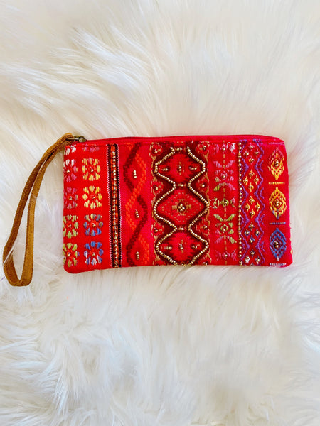 Pouch Wristlets at Multitudes Boutique - The Calla Seed Bead Clutch isn't your average Leather Strap Wristlet! This Clutch Wristlet is Handmade, has an ethnic pattern, and seed bead details. Handmade Purse. Clutch Purse. Multitudes Boutique. Cutest Online Clothing Store. Free Shipping Over $75.
