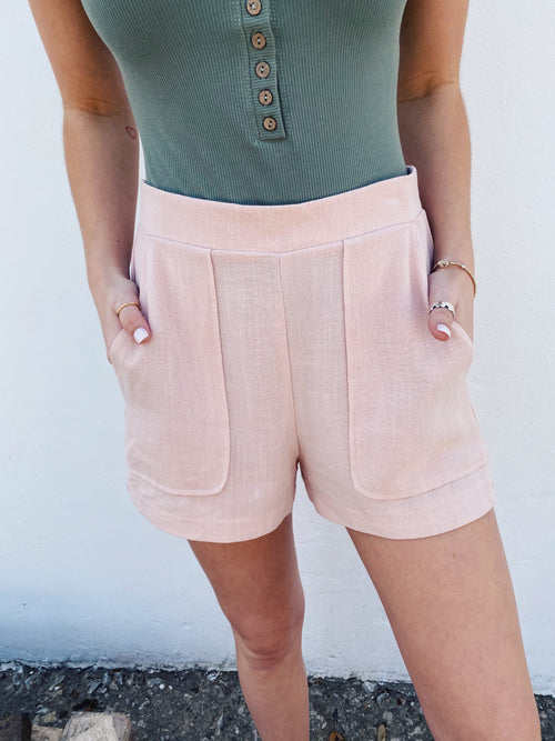 Dressy Shorts at Multitudes Boutique - The Dusty Pink Dress Shorts will up-level your style! These Pink Shorts for Women are a soft blush color, have porkchop pockets, and a back elastic waistband. These Dress Shorts for Women are special! Multitudes Boutique. Cutest Online Clothing Store.