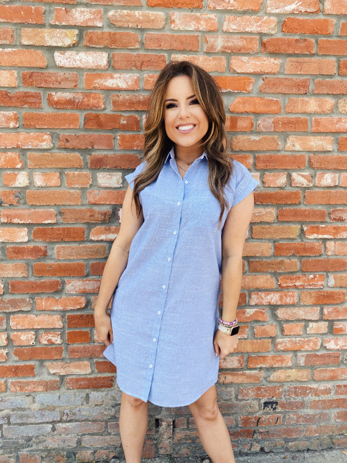 Stay cool while looking cute in the Easy Like Summer Shirtwaist Dress. The Blue Shirt Dress wears like a lightweight button down, yet goes to the just above the knees and has short cuffed sleeves. Pair this Button Down Dress with your favorite sandals or sneakers. Multitudes Boutique. Cutest Online Clothing Store.