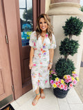Steal all the stares in the Fallon Floral Ruched Dress. Featuring a white background with  floral print, this Ruched Midi Dress has a ruched skirt, a midi length, and a plunging neckline and open slit back. This Floral Midi Dress is perfect for your vacation. Multitudes Boutique. Cutest Online Clothing Store.