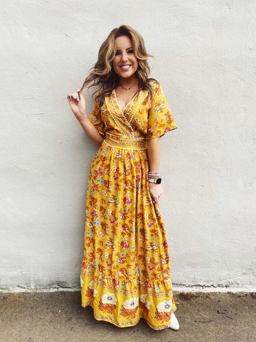 The Walk in the Garden Maxi Dress is perfect for work or play! This Yellow Maxi Dress has a rust, pink, and blue floral print. Wear this Maxi Dress with Sleeves to work, to brunch, or to your next wedding. Mary is Wearing a Small. Runs TTS. Skirt is Lined. Multitudes Boutique. Cutest Online Clothing Store.