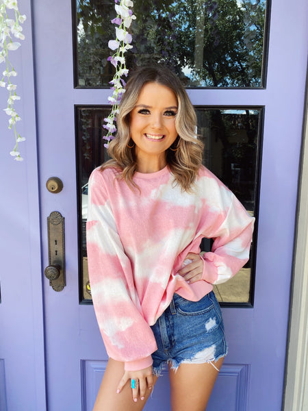 Looking for a Two Piece Lounge Set? Snag this Pink Tie Dye Lounge Top and Shorts! This long sleeve lounge top is made of tie dyed terry knit that looks and feels like clouds! Wear this lounge top with the matching Pink Tie Dye Lounge Shorts or your Mom Jeans and Sneakers! Multitudes Boutique. Cutest Online Boutique.