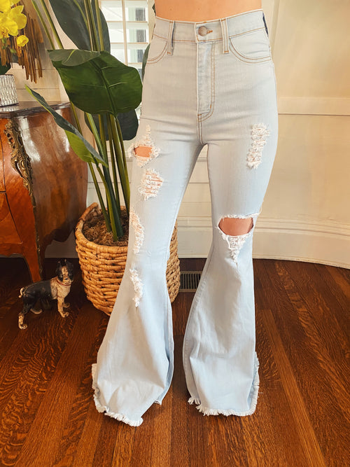 High Rise Flare Jeans at Multitudes Boutique - The Jolene Pale Stone Flares are a customer favorite! If you haven't tried them, you NEED to! But, be fast, they sell out quickly! These High Waisted Bell Bottom Jeans have stretch ans make you look amazing! Multitudes Boutique. Cutest Online Clothing Store. Distressed.