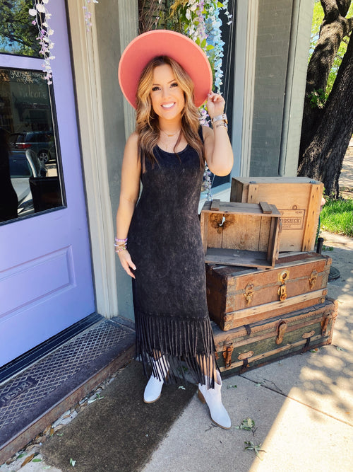 The Mallie Mineral Dye Black Fringe Dress is perfect for the boho gal with a wandering soul! This Casual Midi Dress has a double tier of fringe. Dress with Fringe is sleeveless and made of soft knit. Runs True to Size. Made in the USA. Multitudes Boutique. Cutest Online Clothing Store.