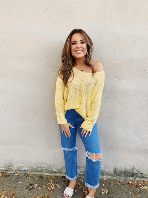 Off the Shoulder Oversized Sweaters at Multitudes Boutique - The Mellow Yellow Beach Lover Sweater is amazing! This Loose Knit Sweater is yellow, can be worn off shoulder, has an oversized fit, and a high-lo hem. This Oversized Sweater for Women will be your favorite! Multitudes Boutique. Cutest Online Clothing Store.