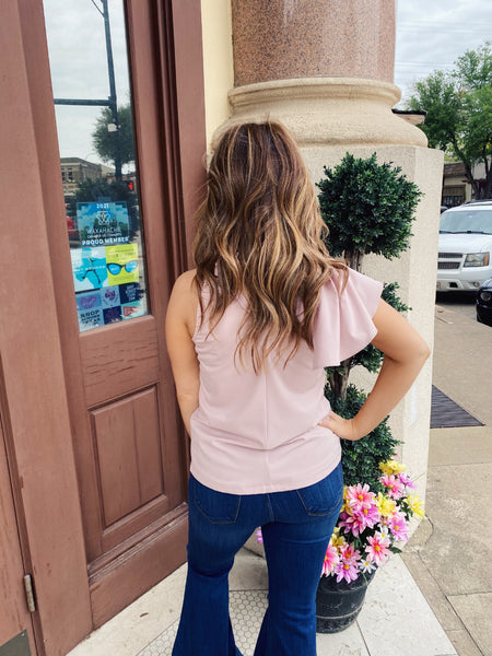 Transcend seasons and occasions with the Olympia One Shoulder Flare Top. This High Neck Top is dustly lavender, sleeveless, and has an extended ruffle on one shoulder. Pair this One Shoulder Ruffle Top with Paperbag shorts or pants for a fun datenight look. Multitudes Boutique. Cutest Online Clothing Store.