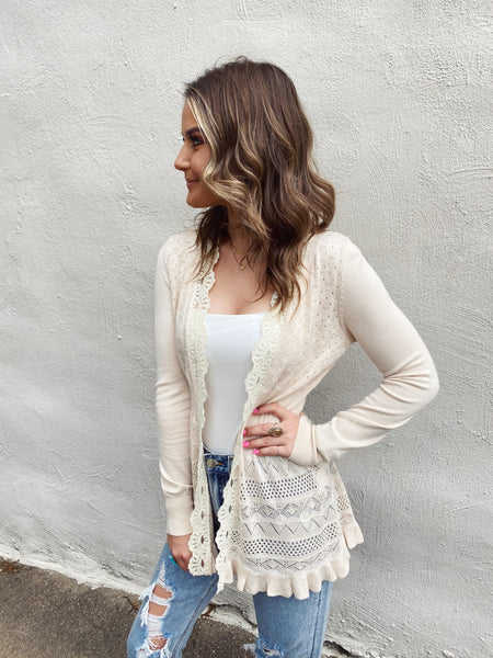 The Paulina Pointelle Cardigan in Off White is a classic with feminine details. The body of this Crochet Cardigan is pointelle, the edging is crochet, and the hem is ruffled. And, the pulled in woven waistline on this White Cardigan Sweater gives a slimming slihouette. Multitudes Boutique. Cutest Online Clothing Store.