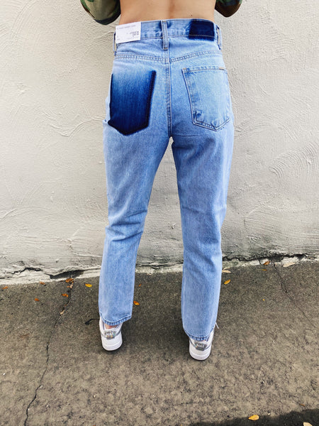 High Rise Mom Jeans at Multitudes Boutique - The Paisley One Pocket Jeans are fun! These High Rise Mom Jeans have a relaxed fit and slit knees. These Light Wash Mom Jeans have dark dyed spots where a pocket and tag would have been, giving them a Vintage Mom Jean look! Multitudes Boutique. Cutest Online Clothing Store.