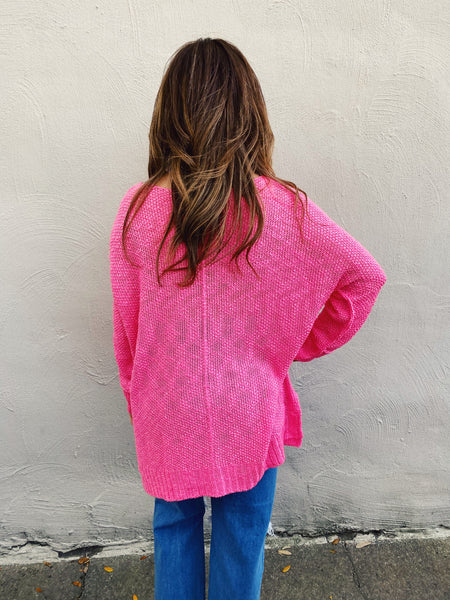 Off the Shoulder Oversized Sweaters at Multitudes Boutique - The Perfect Pink Beach Lover Sweater is amazing! This Loose Knit Sweater is bright pink, can be off shoulder, has an oversized fit, and a high-lo hem. This Oversized Sweater for Women will be your favorite! Multitudes Boutique. Cutest Online Clothing Store.