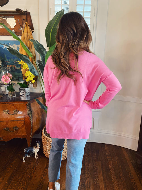Soft Tunic Sweaters at Multitudes - The Pink Soft Basic Tunic Top is for every age! This Tunic Sweater is soft, has a v-neck, a seam down the front, long sleeves, and a hi-lo hem with side slits. This Women's Tunic Sweater is one you will wear again and again! Multitudes Boutique. Cutest Online Clothing Store.