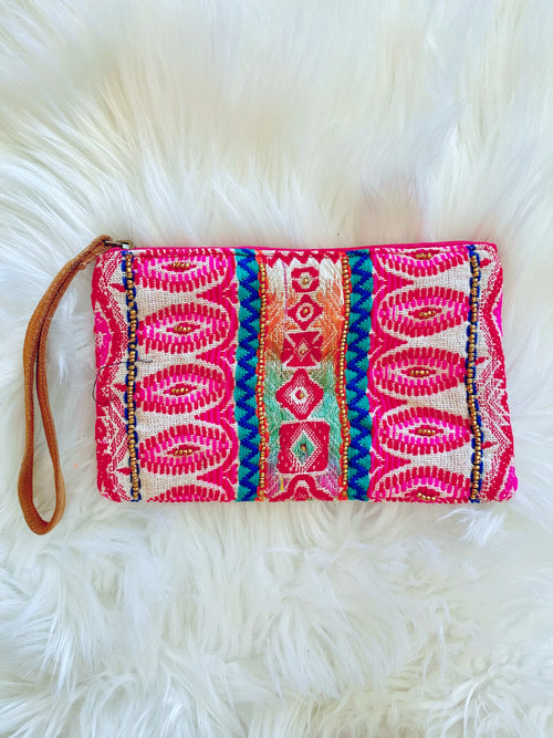 Pouch Wristlets at Multitudes Boutique - The Siona Seed Bead Clutch isn't your average Leather Strap Wristlet! This Clutch Wristlet is Handmade, has an ethnic pattern, and seed bead details. Leather Strap Wristlet. Clutch Purse. Multitudes Boutique. Cutest Online Clothing Store. Free Shipping Over $75.