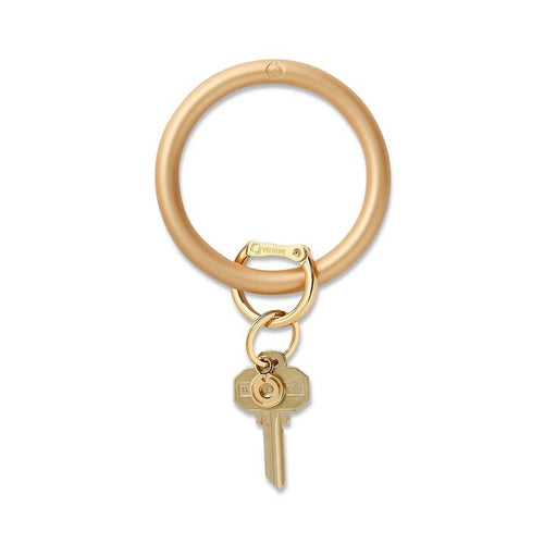 Silicone Big O® Key Ring METALLIC The Gold Rush Metallic Silicone Key Ring has arrived for Holiday 2020! The Metallic Silicone has a subtle, pearlescent, waterproof shimmer. The Original Big O Key Ring is a one-size-fits-all bracelet key ring. Stocking Stuffer. Oventure. Multitudes Boutique. Cutest Online Boutique.