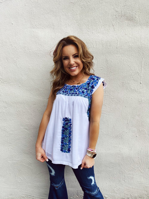 The Cecelia Embroidered Top by J. Marie Collections is stunning! This Classic Blue and White Embroidered Mexican Top will look amazing with your darker denim jeans and shorts! Model is Wearing an SMALL. Runs TTS. Lined. Mexican Tops. Multitudes Boutique. Cutest Online Clothing Store.