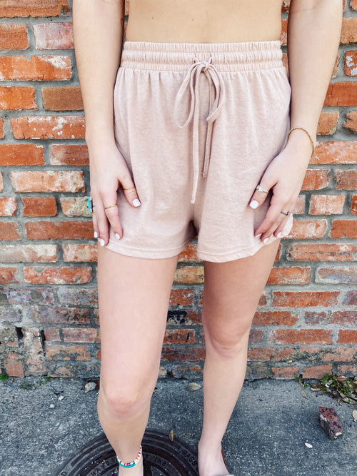 Two Piece Short Sets at Multitudes Boutique - The Basic Tan Lounge Shorts are a MUST-HAVE! Wear this Knit Lounge Set with the matching Basic Tan Lounge Top. These Lounge Shorts are knit, have an Elastic Waist, and a tie at the waist. Short Set for Women. Multitudes Boutique. Cutest Online Clothing Store.