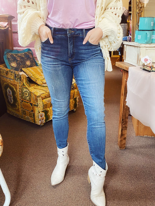 High Waisted Skinny Jeans at Multitudes Boutique - Looking for a pair of Connie High Rise Ankle Skinny Jeans, then snag them here! The Connie Ankle Skinnies have a great fit! These Kut from the Kloth skinnies have a button fly, are high rise, and have no distressing. Multitudes Boutique. Cutest Online Clothing Store.