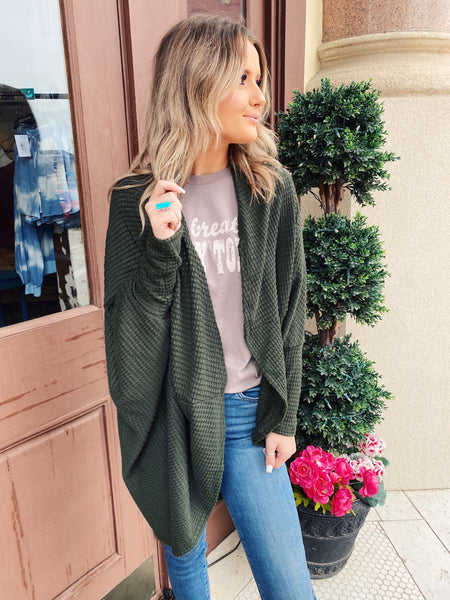 Love a great Batwing Cardigan? Then snag this Olive Waffle Knit Cocoon Cardigan! You can wear this cardi over graphic tees, tank tops, and crops. You can wear it out or while lounging in. It's versatile and cute and you will be so glad you snagged it! Multitudes Boutique. Cutest Online Boutique. Cocoon Cardi.
