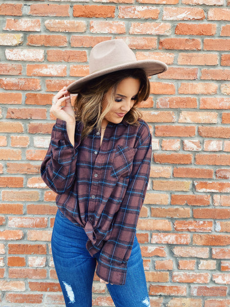 Brown Flannel Shirt by Multitudes. This Chocolate Plaid Boyfriend Flannel is a classic! This women's brown flannel shirt is oversized, soft, and has brown, black, and hunter green plaid. This Brown Flannel Shirt is perfect for everyday wearing! Multitudes Boutique. Cutest Online Boutique. Honeysuckle Tees.