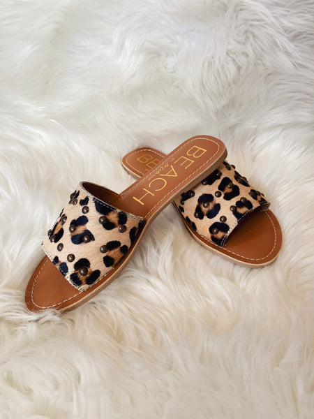 Slide around town in the Salty Studded Leopard Sandal by Matisses Shoes! THese Slide Sandals will add a bit of flair to any outfit with a classic single band or exotic animal print and stud detailing. This is an undeniably chic slide sandal. Multitudes Boutique. Cutest Online Clothing Store.