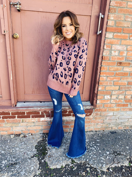 Leopard Print Sweater at Multitudes Boutique - The Spots of Gold Cheetah Sweater is stunning with black and touch of gold cheetah spots on that dusty mauve background. Dress it down with jeans for everyday, or dress it up with a skirt for  your next holiday party! Multitudes Boutique. Cutest Online Boutique.