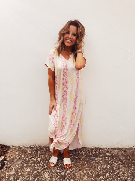 Are you looking for a comfy Cotton Maxi Dress? Then snag this Sunrise Snake Print Maxi! This one is so trendy with an oversized style and snake print, but it's the colors that make it special! This Jersey Maxi Dress is perfect to wear to dinner after a day in the sun! Multitudes Boutique. Cutest Online Boutique.