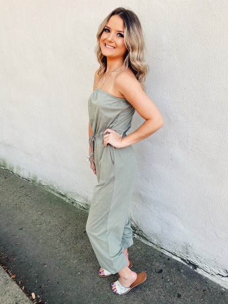 Strapless Waist Tube Jumpsuits are trending, especially when they're strapless jumpsuits and jogger style jumpsuits. That's why we love this Olive Strapless Knit Jumpsuit. As it reads, it's strapless, is styled as a jogger, and has an elastic waistband with faux drawstring! Multitudes Boutique. Cutest Online Boutique.