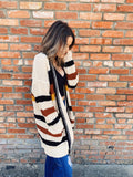 Chunky Knit Sweaters are trending and this Fall Striped Chunky Knit Cardigan will be your favorite! This Chunky Cardigan is the perfect weight and those fall stripes in mustard, rust and black remind us of what we love about this time of year! Snag this Chunky Knit Sweater! Multitudes Boutique. Cutest Online Boutique.