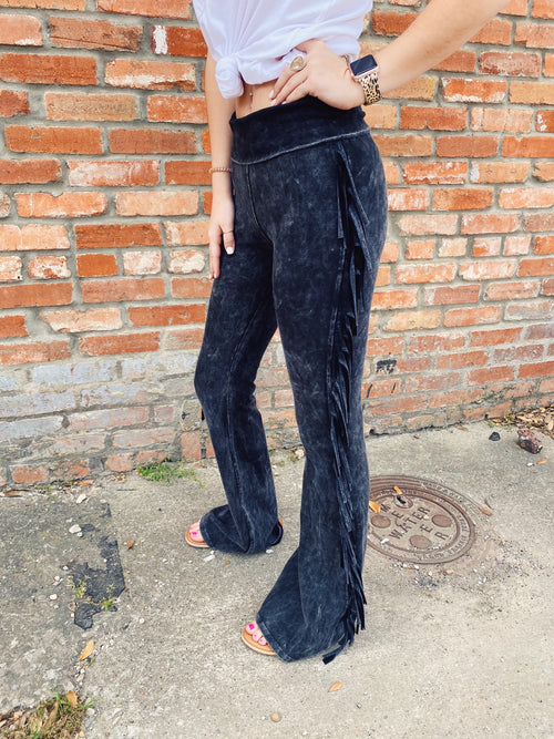 If you're feeling boho, or like dressing with flair, get the Black Side Fringe Knit Pants! These Fringe Pants are made of soft black mineral washed knit, are flared, are high waisted, and have fringe going down the sides of both legs. Multitudes Boutique. Cutest Online Clothing Store.