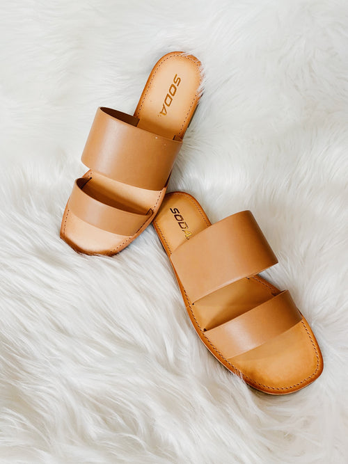 The Karen Blonde Flat Slide Sandal will be that flat you will wear day after day! This Open Toe Sandal features double straps, a semi-padded footbed, and a squared off toe. You will LOVE these Cute Summer Sandals! Double Strap Slide Sandals. Runs True to Size. Multitudes Boutique. Cutest Online Clothing Store.