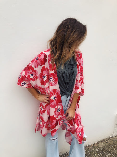 Are you looking for a new Beach Kimono? Then get the Red Flowy Floral Kimono! The  red floral print on the light pink background will ensure you are the brightest at the party! Wear it over your shorts and white crop top, or as a kimono cover up at your next pool party! Multitudes Boutique. Cutest Online Boutique.