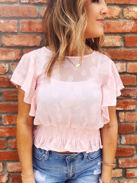 The Pink Flutter Sleeve Floral Top is adorable, so if you're looking for a cute Flutter Sleeve Crop Top, snag this one! We see you wearing this Flutter Sleeve Crop Top with a cute skater skirt to your next outdoor wedding, and then later with your distressed jean shorts for a party in the field! Multitudes Boutique.