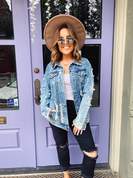 Looking for your next favorite Oversized Jean Jacket? Then snag this Acid Wash Distressed Boyfriend Denim Jacket! Girl, this oversized denim jacket will take you everywhere! Wear it over all your dresses, Honeysuckle tees, and crops! Honeysuckle Tees. Multitudes Boutique. Cutest Online Boutique.
