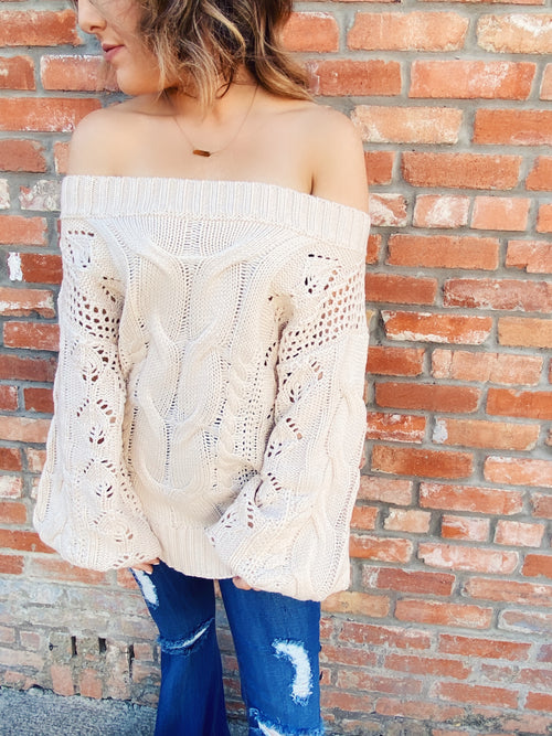 Off the Shoulder Sweater at Multitudes Boutique - The Natural Oversized Cable Knit Sweater is stunning! First, that oversized cable! Add the Off the shoulder style, and this sweater is a winner! This Cable Sweater fits oversized for a trendy look. Cream Sweater. Multitudes Boutique. Cutest Online Boutique.