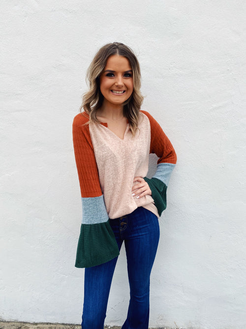 Looking for a Bell Sleeve Top to wear this fall? Then get this Fall Vibes Bell Sleeve Top! This Bell Sleeve Top is fun and unique, and you will be the envy every time you wear it! Just picture yourself wearing this with your flare jeans and brim hat! What a cute fall look! Multitudes Boutique. Cutest Online Boutique.